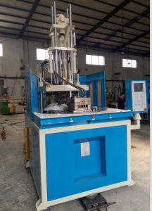 Factory Supply Rotary Table Plastic Vertical Injection Molding Machines pictures & photos