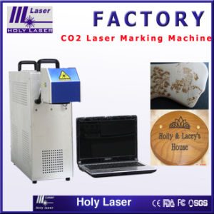 Desk Model CO2 Laser Marking Machine for Nonmetal pictures & photos