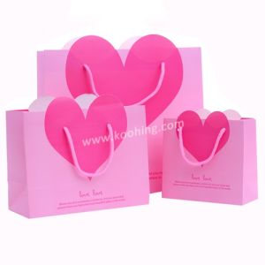 Pink Cardboard Gift Bag with Heart Embedded pictures & photos