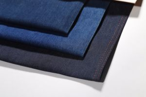 Indigo Twill Cotton Polyester Stretch Mercerizing Denim Fabric 9.7oz pictures & photos