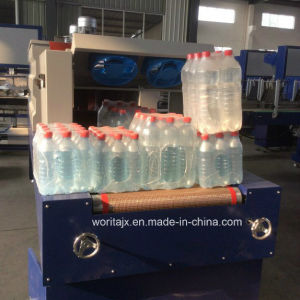 Wd-150A Shrink Film Packing Machinery for Cosmetic Bottles (WD-150A) pictures & photos