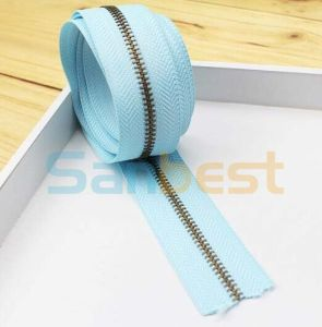 High Quality Metal Zipper with Light Blue Tape pictures & photos