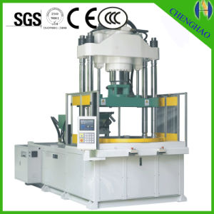 Vertical Type Injection Molding Machine with Vertical Clamping Horizontal Injection pictures & photos