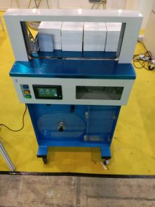 Automatic Belt Roll Strapping Machine pictures & photos