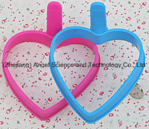 Popular Heart Shape Silicone Egg Mould Silicone Egg Holder Se09 pictures & photos