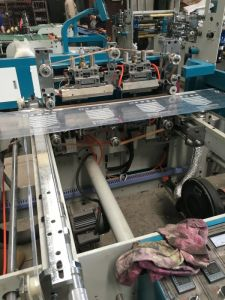 Full Automatic PE Zipper Bag Making Machine with Zipper Head Attaching (BC600) pictures & photos
