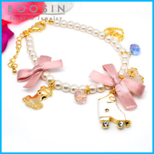 Pink Sweet Bow Tie Charm Metal Bracelet #31449 pictures & photos