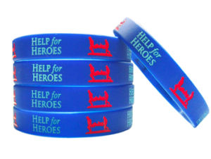 Personalized Logo Deboosed Ink Filled Silicone UK Wristband for Charity pictures & photos