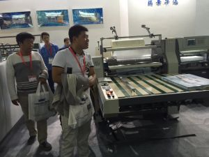 Semi-Auto Glueless Hot Lamination Machine with Cutting pictures & photos