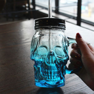 Skull Shape Glass Bottle for Christmas and Easter Festival pictures & photos