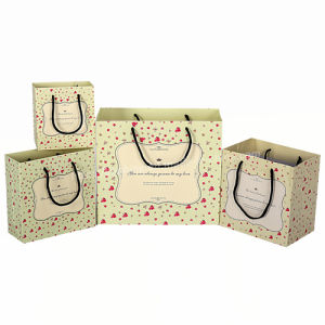 Factory Custom Luxury Outlet OEM Black Gift Paper Bag with Silk Ribbon Handle for Woman pictures & photos