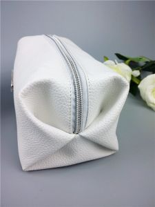 Soft PU with Metal Plate Litchi Stria and Continuos Prited Lining Pouch Cosmetic pictures & photos