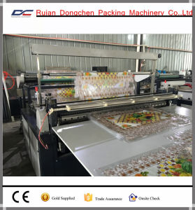 Vinyl Table Cloth Roll to Sheet Cutting Machine with Rotary Blade Tem Triming (DC) pictures & photos