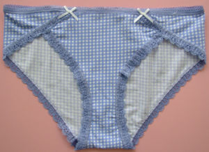 China Girl′s Brief with Lace Trim and Bow pictures & photos