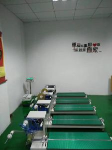 Emboss Carrier Taping Machine for All Kinds of Components pictures & photos