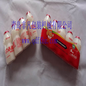 China Factory Price Automatic Yakult Bottle Shrink Wrapping Machine pictures & photos