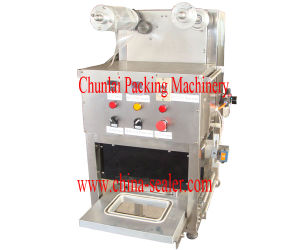Kis Pneumatic Plastic Tray Sealing Machine pictures & photos