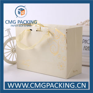 Luxury Warm Beige Color Wedding Paper Bag with UV Printing (CMG-MAY-019) pictures & photos