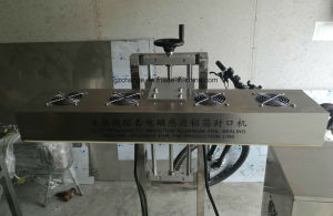 Automatic Bottles Jars Aluminum Foils Sealing Machine pictures & photos