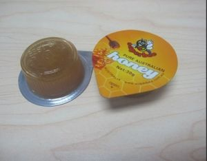 Dpb-120L Automatic Honey Jam Small Cup Blister Packing Machine pictures & photos