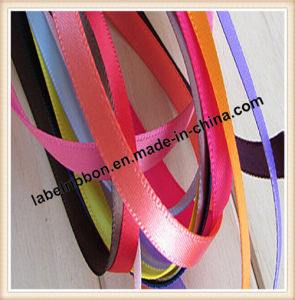 Customized Color Woven Edge Polyester Satin Ribbon (SW500) pictures & photos