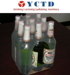 Semi-Automatic Pet Bottle Sleeve Film Shrink Wrapping Machine (YCTD) pictures & photos