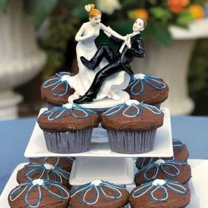 """ Taking a Plunge "" Bride & Groom Wedding Cake Topper Figurine pictures & photos"