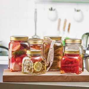 a Series Embossed Pattern Glass Bottle for Storage and Pickles pictures & photos