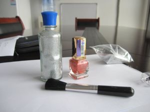The Application of Spring Glitter Powder on Nail Polish pictures & photos