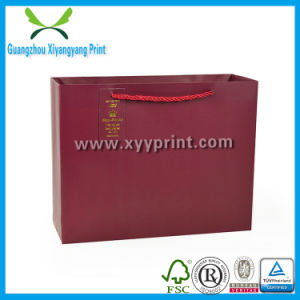 Customized Kraft Paper Gift Bag with Ribbon Wholesale pictures & photos