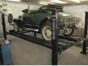 Ce Movable Four Post Hydraulic Car Parking Lift with Wheels and Jack pictures & photos