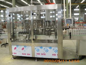 Automatic Filling Machine for Wine in Glass Bottles pictures & photos