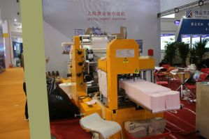 Automatic on The Glue and Color Embossing Napkin Paper Folding Machine pictures & photos