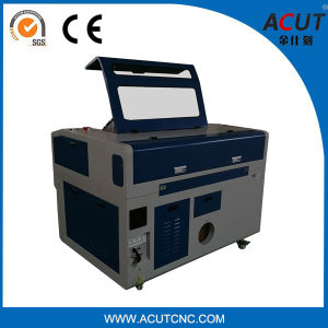 1390 Laser Cutting Machine with Reci Laser Tube pictures & photos