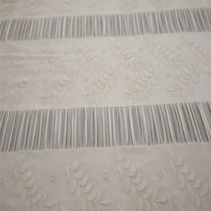Hot Sale Polyester Spandex Floral Embossed Knit Garment Fabric pictures & photos