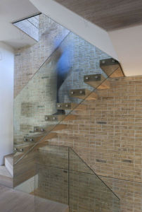 Standoff Glass Balustrade Design for Interior Staircase Fence pictures & photos