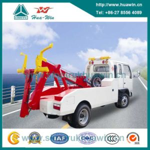 Sinotruk HOWO Crane Tow Crane 4X2 Flatbed Road Wrecker Truck pictures & photos
