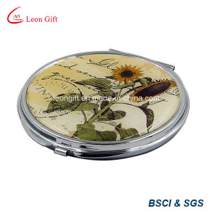 Professional Round Metal Makeup Mirrors with Cut out Deaign pictures & photos