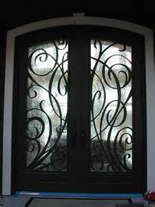 Low Cost Decorative Wrought Iron Entry Doors (UID-D129) pictures & photos