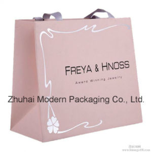 Wholesale Cheap Price Silver Hot Stamping Paper Bag with Handle pictures & photos