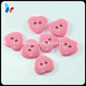 Heart Shape Two Holes Pink Resin Button for Baby Clothing pictures & photos