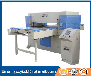 Double-Side Auto-Feeding Table Precision Four-Column Hydraulic Plane Cutting Press pictures & photos