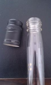 Glass Bottle with Screwed Safety Ring Cap pictures & photos