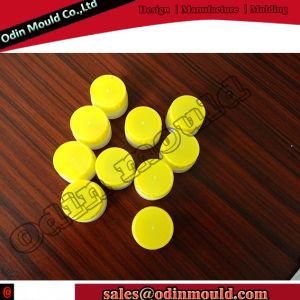 Multi Cavity Oil Bottle Top Lid Plastic Mould pictures & photos