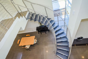 Arc Staircase with Stainless Steel Rod Balustrade and Wood Tread pictures & photos