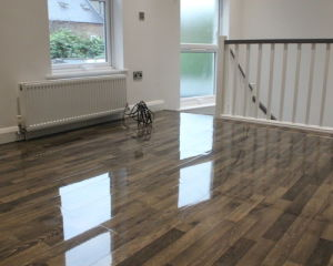HDF High Glossy Waterproof Laminate Flooring pictures & photos