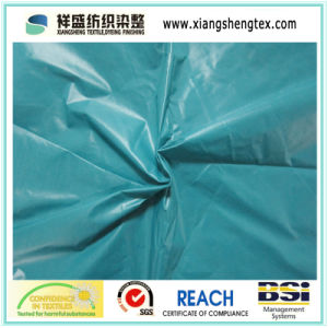 Circular Hole Nylon Taffeta Fabric with Oil Cire (380T) pictures & photos