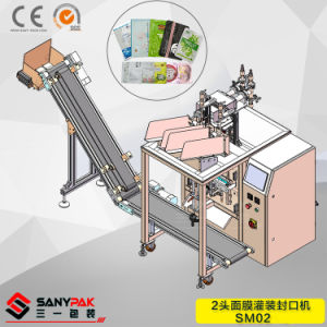Auto Two Head Face Mask Machine with Folding Filling Sealing Function pictures & photos