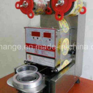 manual Plastic Cup Sealing Machine with One or Several Mould pictures & photos