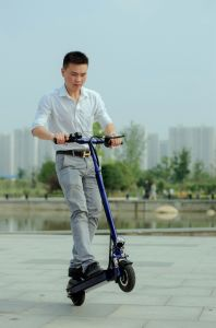 Double Wheels Electric Long Riding Range Kick Surfing Skateboard pictures & photos